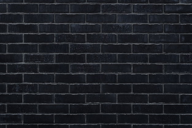 Muur van zwarte baksteen textuur achtergrond voor ontwerp