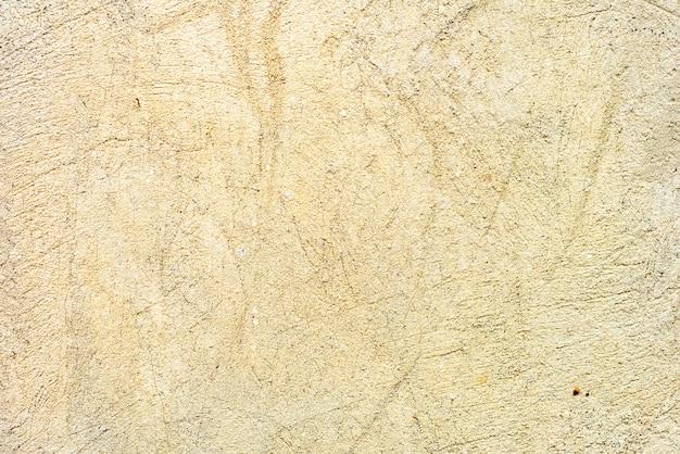 Muurfragment met krassen en scheuren