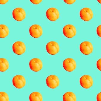 Naadloos patroon met abrikozen op een groene achtergrond. minimale isometrische textuur van voedsel.