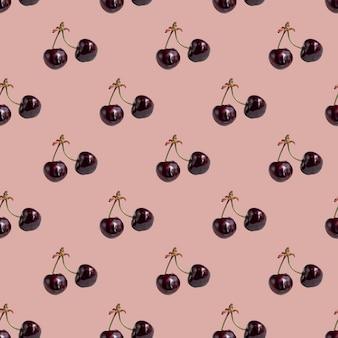Naadloos patroon met kersen op een takje op een roze achtergrond. minimale isometrische textuur van voedsel.