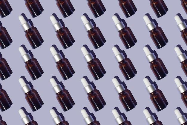 Naadloos patroon van serums met collageen op paarse achtergrond