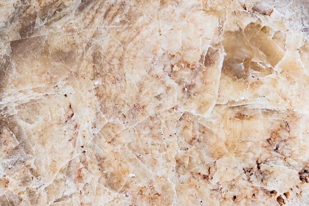 Naadloze achtergrond textuur van natuurlijke ruwe steen bruin graniet