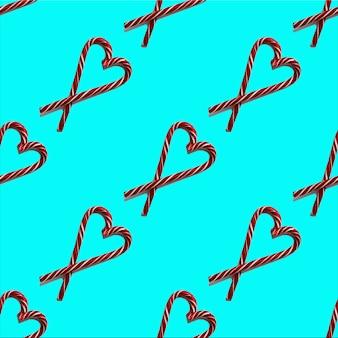 Naadloze patroon hartvorm met kerst snoepjes op een blauwe achtergrond, bovenaanzicht, minimalisme. kan worden gebruikt als wenskaarten voor kerstmis en nieuwjaar, valentijnsdag, achtergrond