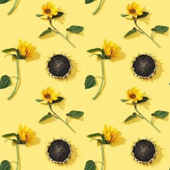 Naadloze patroon van gele zonnebloemen en zwarte zaden.