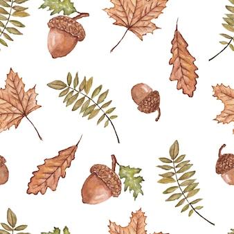Naadloze patroon van herfstbladeren en eikels aquarel geschilderd op wit
