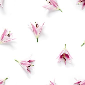 Naadloze patroon van roze leliebloemen