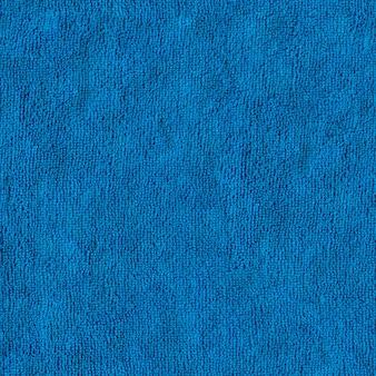 Naadloze tegelbaar textuur van blauwe microfiber textiel oppervlak