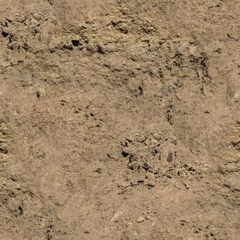 Naadloze textuur - droge gebarsten kleimuur