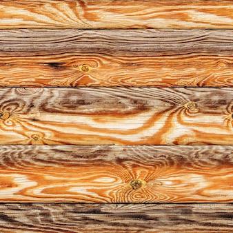 Naadloze textuur van houten muur van pijnboomlogboeken.