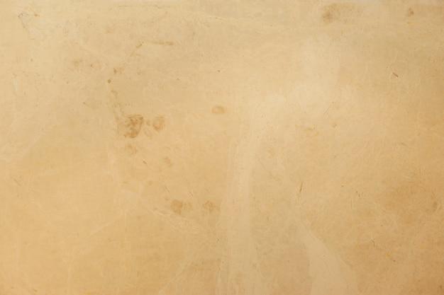 Naadloze zachte beige marmeren textuur