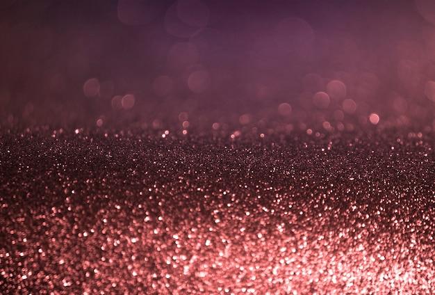 Nam gouden violette abstracte bokehachtergrond toe