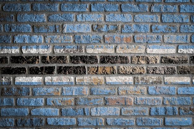 Nationale vlag van botswana op een oude bakstenen muur