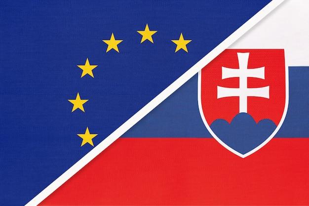 Nationale vlag van de europese unie of eu versus slowakije of slowaakse republiek van textiel.