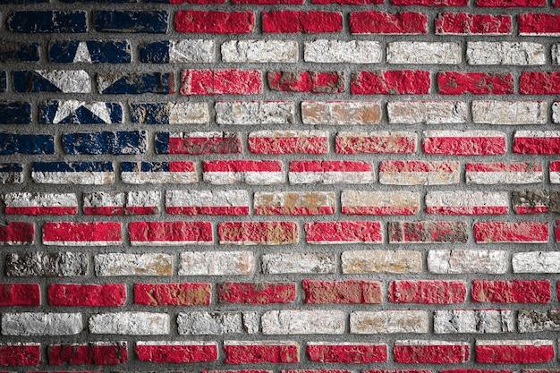 Nationale vlag van liberia op een oude bakstenen muur