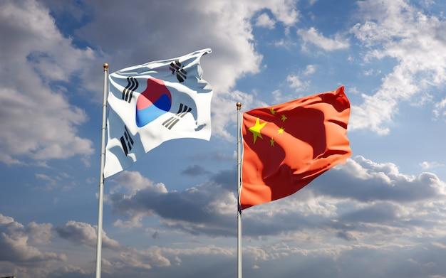 Nationale vlaggen van zuid-korea en china samen