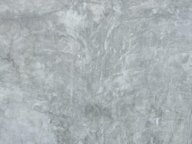 Natuurlijk buiten gebarsten patroon van grijze cementmuur