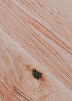 Natuurlijk hout met knoopachtergrond