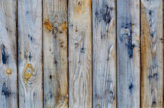 Natuurlijk hout van een hekplanken zonder verf