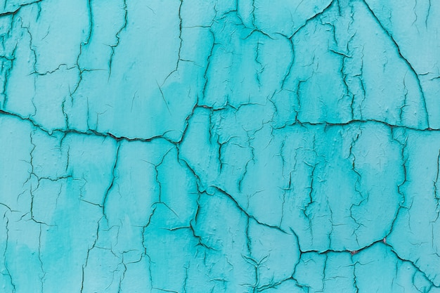 Natuurlijke abstracte achtergrond van geweven blauwe gebarsten muur.