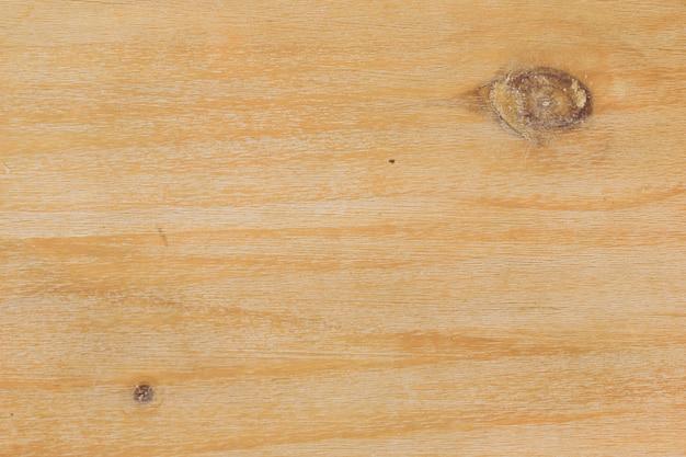 Natuurlijke eiken of grenen houten achtergrond met een grote knoop en een kleine.
