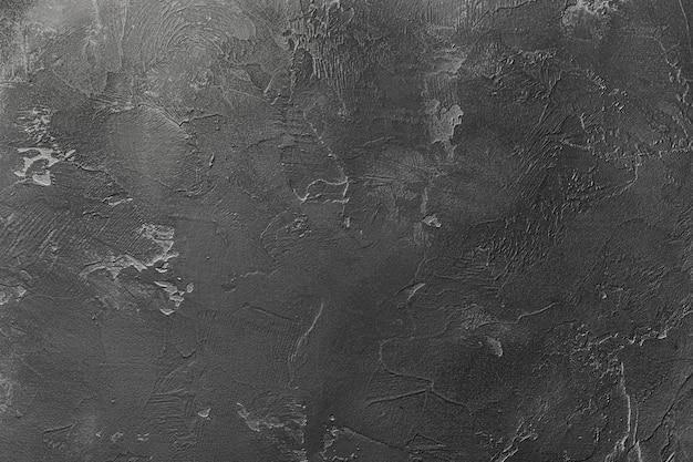 Natuurlijke gestructureerde abstracte achtergrond van decoratieve muur van donkergrijze kleur.