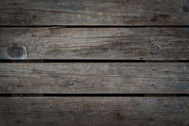 Natuurlijke grijze doorbranden verouderde hout achtergrondstructuur. horizontaal. vignet