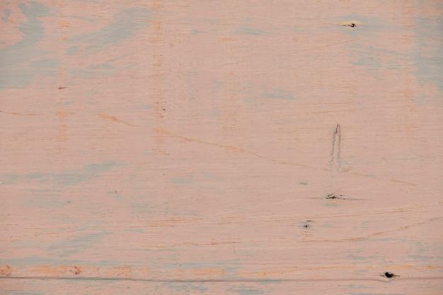 Natuurlijke houten achtergrond geschilderd in licht roodbruine kleur, oude plank, verweerd en bekrast, zeer gedetailleerde foto