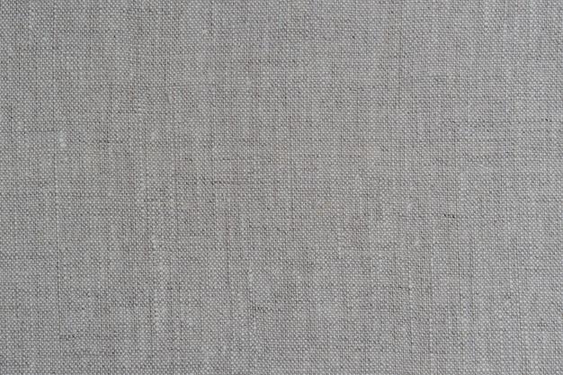 Natuurlijke linnen textuur achtergrond met delicaat raster, licht beige canvas textuur
