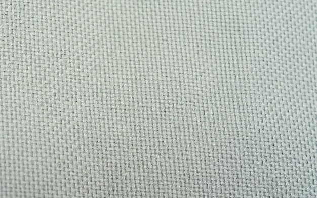 Natuurlijke linnentextuur als achtergrond. close-up stof textiel textuur achtergrond in een hoge resolutie macro weergave. artistieke achtergrond, wit linnen canvas, close-up