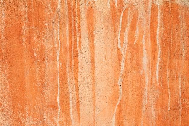 Natuurlijke rode de muur van de kleigrond textuur als achtergrond.