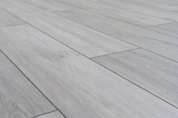 Natuurlijke solide houtsoorten laminaat parketvloer textuur close-up stilleven achtergrond
