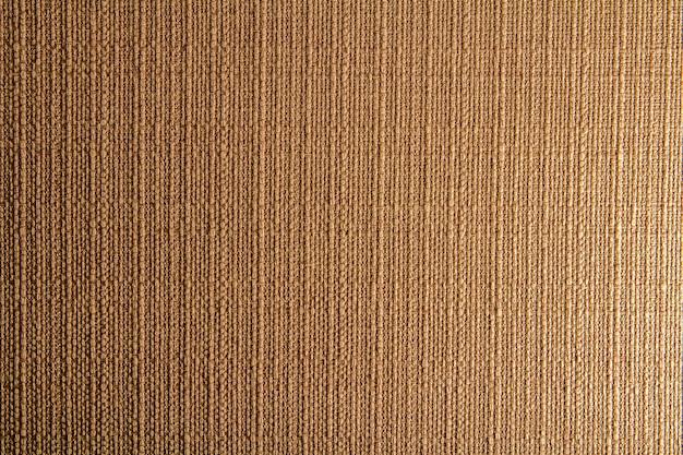 Natuurlijke stof linnen textuur ontwerp. rouwgewaad. bruine canvas achtergrond. katoen.