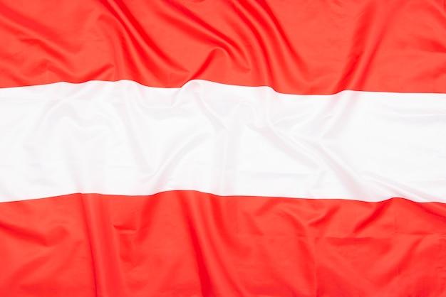 Natuurlijke stof vlag van oostenrijk als bitmappatroon of achtergrond