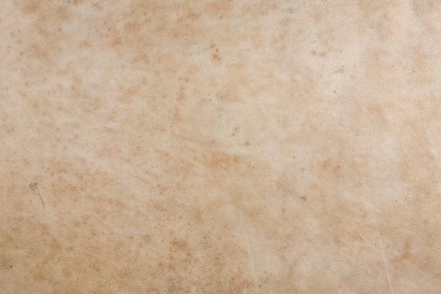 Natuurlijke tan lederen textuur achtergrond