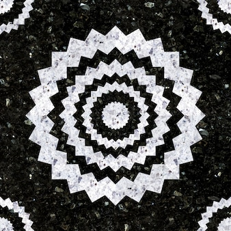 Natuurstenen tegels. mozaïek in wit en zwart gepolijst graniet.