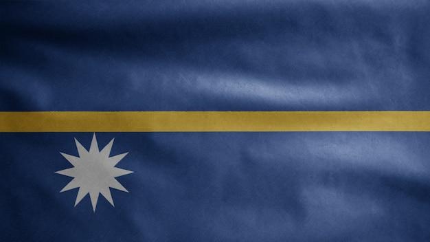 Nauruaanse vlag zwaaien op wind. nauru banner waait, zachte en gladde zijde. doek stof textuur vlag achtergrond