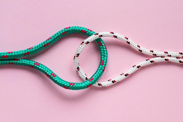 Nautische groene en witte touwknopen