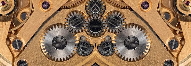 Nauwe weergave van oud klokmechanisme met tandwielen en tandwielen voor uw succesvolle bedrijfsontwerp macro