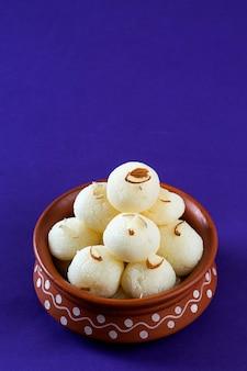 Ndian sweet of dessert - rasgulla in aarden pot