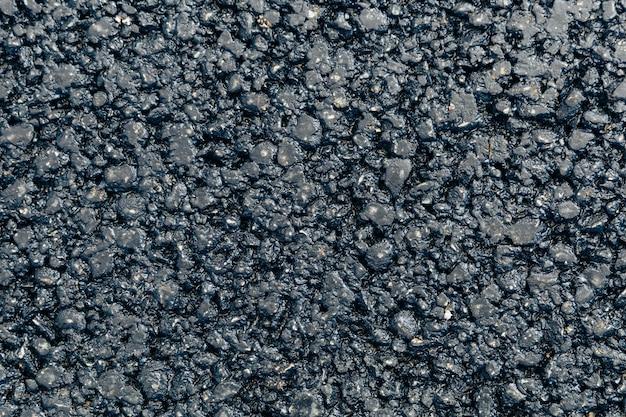 Nieuw bovenaanzicht van de asfalttextuur