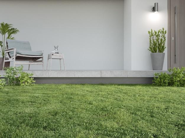 Nieuw huis met fauteuil op betonnen vloerterras en lege witte muur