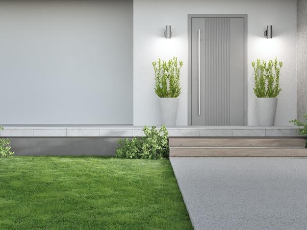 Nieuw huis met grijze deur en lege witte muur