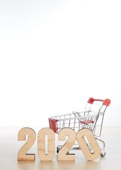 Nieuw jaar 2020 festival winkelen concept op houten