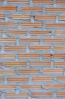 Nieuwe bakstenen muur voor achtergrond