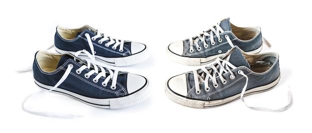 Nieuwe en oude blauwe generieke geïsoleerde sneakers