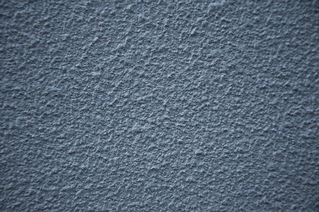 Nieuwe grijze cementmuur. mooi betonnen stucwerk. geschilderd cement. achtergrond textuur muur
