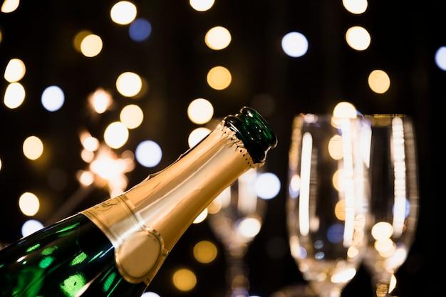 Nieuwe jaarachtergrond met champagne