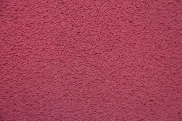 Nieuwe roze cementmuur. mooi betonnen stucwerk. geschilderd cement. achtergrond textuur muur