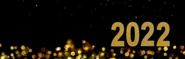 Nieuwjaar 2022 op abstracte wazige lichten in de nacht in panoramisch uitzicht -wenskaart