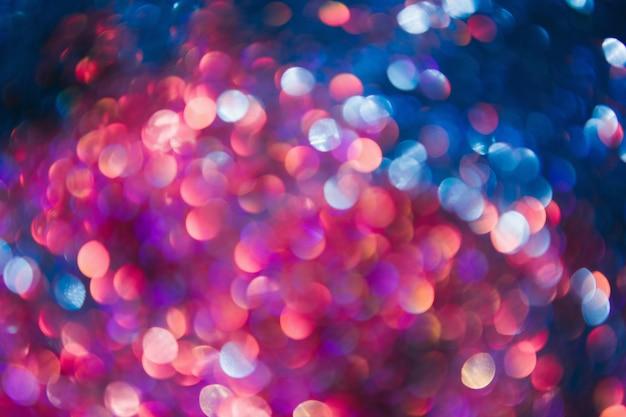 Nieuwjaar feestelijke achtergrond. intreepupil bokeh vervagen fakkels. kleurrijk abstract fonkelend lichtconcept